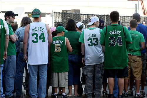 Celtics fans held their spots along Causeway Street in anticipation of the parade.