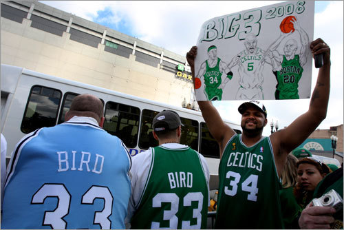 Outside the Garden, Marcial Quinonez (right), of Woburn, paid tribute to the new Big Three, while Bob Messina (left), of Boston, and David Jimenez of Woburn remembered past greats.