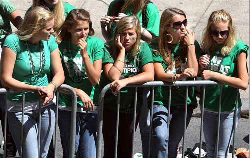 A group of girls with shamrock-painted faces waited for the Celtics rolling rally to begin on Boylston Street.