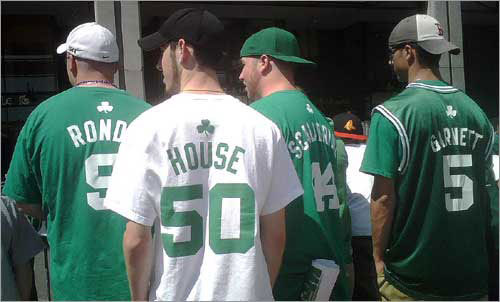 A group from Litchfield, N.H., waiting for the Celtics players to arrive, turned toward the parade route.
