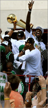 With the Garden behind them, Garnett (waving) and the Celtics rolled onto Causeway Street.