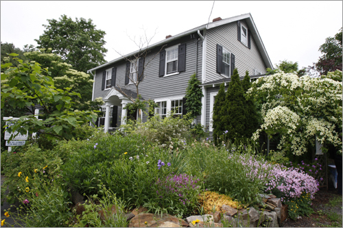 Fred Rice is the home owner of this house built in 1927 and located on 9 Friend Street in Manchester-by-the-Sea. The house is surrounded by lush English-style gardens.
