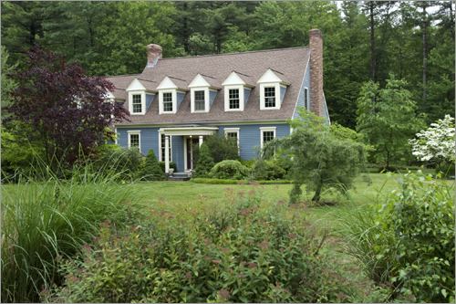 This custom Cape at 4 Ohlin Ave. in Harvard has expansive gardens and flowering trees on more than one and a half acres.