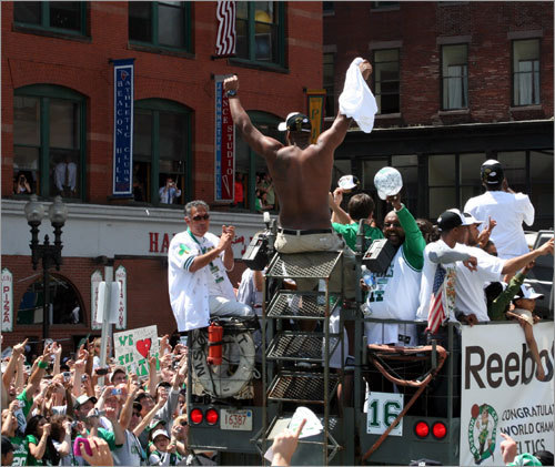 Big Baby salutes the crowd as the rally gets rolling down Causeway Street in Boston this morning.