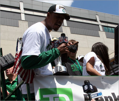 Paul Pierce takes some microphones and addresses the media before the rally got rolling. Pierce said they lit the cigars to honor Celtics legend Red Auerbach.