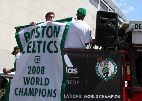 Celtics owner Wyc Grousbeck shows off the 2008 championship banner before the rally.