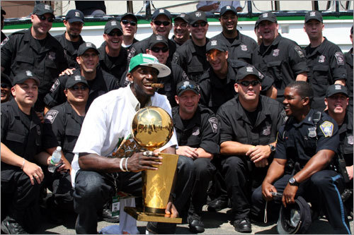 As the Boston Police Special Operations Unit was posing for a group photo, Kevin Garnett popped into the scene with the championship trophy.