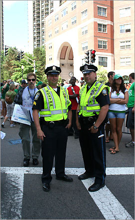 Have you worked the other Boston celebratory parades? 'Absolutely. I worked all of them,' said Sgt. Dan McLaughlan of the Boston Police Department, left. Also pictured: Michael Byrnes of the Boston Police Department, right.