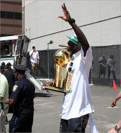 Kevin Garnett makes his way out of the Garden with trophy in hand before the rally.