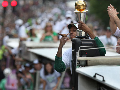 Pierce, with a cigar and the MVP trophy, celebrated the victory at the rolling rally.