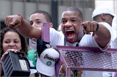 Coach Doc Rivers was fired up, pointing to the fans at the rally.