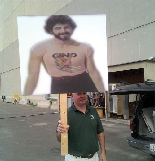 Celtics DJ Dan McCarthy breaks out a super-sized Gino sign before the rally.