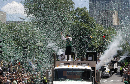Lucky, the Celtics mascot, stood atop the lead truck in the parade as the Celtics rolled down Tremont Street. Buy the Globe's commemorative book