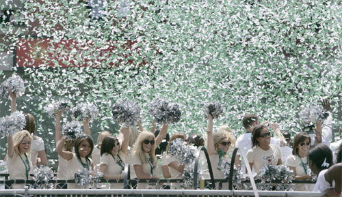 Celtics dancers were covered in confetti as they made their way through the city on a flatbed truck in the rolling rally.