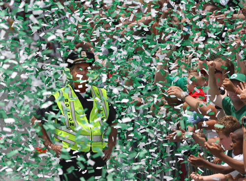 A Boston police officer was as happy as the fans as confetti fell on him and the parade strolled by on Boylston Street.