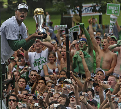 Paul Pierce held up the Most Valuable Player trophy for fans to see and share in the special moment.