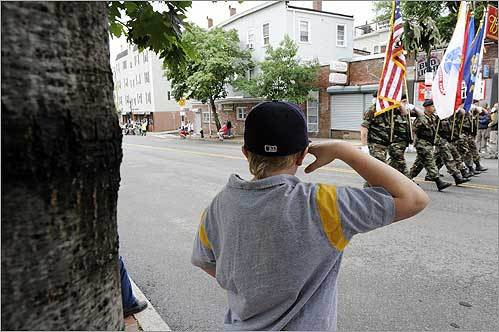 Chris Fidler, 11, of Charlestown saluted the American flag as the Bunker Hill Day Parade marched up Bunker Hill Street in the Charlestown section of Boston.