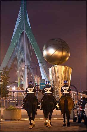 Boston Police officers with the mounted unit patrolled near the TD Banknorth Garden in front of a huge replica of the NBA trophy.