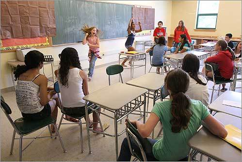 Brianne Hansen (left) and Palloma Jovita acted out a game in sixth-grade French class on the last day of school at the Cameron Middle School in Framingham.