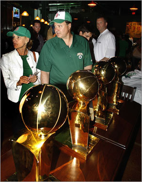 Celtics co-owner and managing partner Steve Pagliuca looks over the team's trophies at a pregame party inside The Bleacher Bar at Fenway.