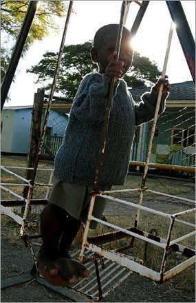 A handicapped child plays on a swing at an orphanage in Harare, Saturday June 7, 2008.