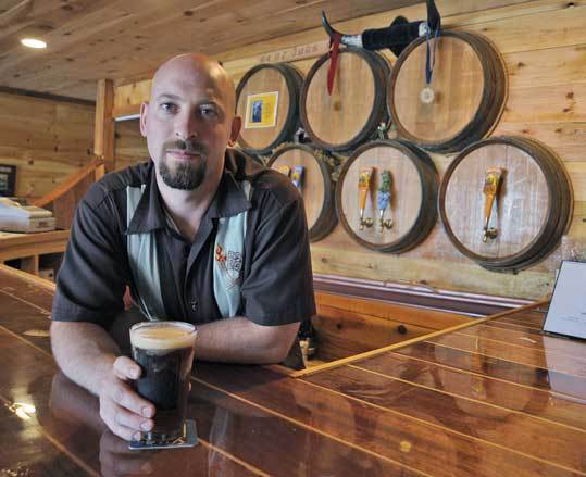 Jeremy Goldberg, co-owner and head brewer of Cape Ann Brewing Co., a four-year-old microbrewery that received a permit to serve beer during St. Peter's Fiesta.