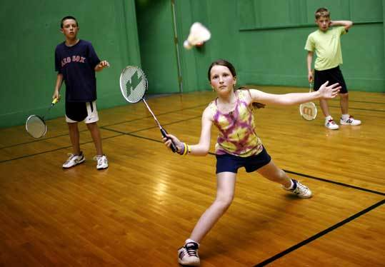 Nicole Frevord stretches to make a play during badminton practice. Marblehead Youth Badminton will host a tourney beginning June 28.