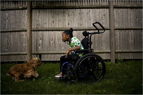 Kai Leigh Harriott, shown with her dog, Jaireh, at home in Roxbury, said clinging to anger would darken her life. Kai Leigh was paralyzed from the waist down by a shot fired into the air by Anthony Warren, who is serving a 13- to 15-year sentence. Warren, who participates in inmate support groups and the Alternative to Violence program, recently said, 'I feel every day that I wake up it's a constant reminder of the things I did.'