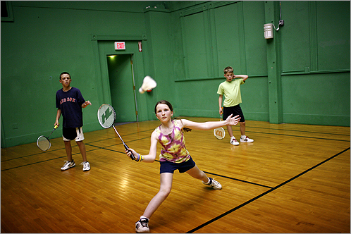Nicole Frevord stretched to make a play during badminton practice at the Gut 'n Feathers in Marblehead.