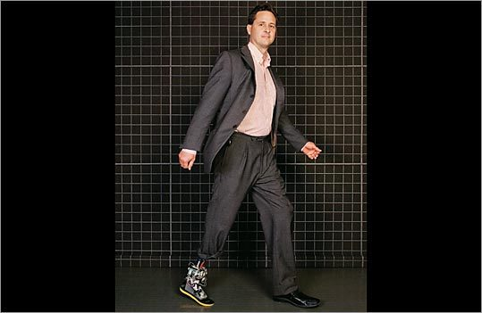 Hugh Herr wears a robotic prosthesis still under development on his right leg and a more conventional one on his left.