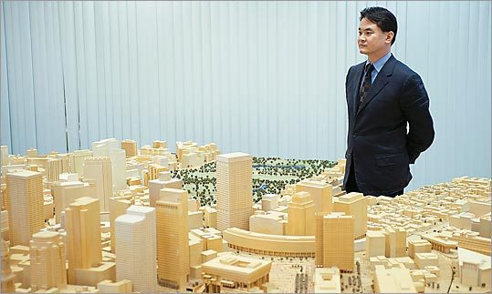 Kairos Shen stands beside a model of the city at the Boston Redevelopment Authority.