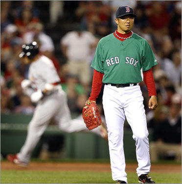 Okajima struggles After allowing two earned runs in 24 innings for the first two months of the season, Hideki Okajima allowed 10 in his next 9 1/3. He blew saves against the Orioles on June 2 and 10, and here he gave up a shot to St. Louis' Yadier Molina in a 5-4 Red Sox loss on June 20. He has allowed 12 of his last 15 inherited runners to score.