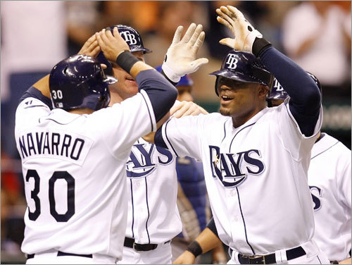 Rays catch fire, sweep Cubs Tampa Bay recovered nicely from its Fenway failure. From June 17-19, the Rays swept the Cubs, who then had the best record in baseball. In the finale, Carl Crawford's grand slam was part of a seven-run seventh inning in an 8-3 win.