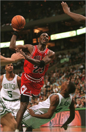 Buy photographs by Pat Greenhouse Michael Jordan drives on a falling Chauncey Billups in the Bulls' loss to the Celtics in the 1997 season opener.