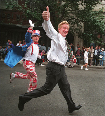 Buy photographs by Pat Greenhouse Governor Bill Weld, shadowed by 'Uncle Sam,' sprints up Hanover Street in the North End during the Columbus Day parade in 1995.