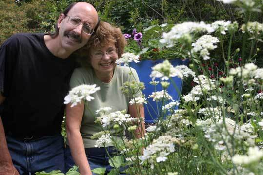 Photographers Paul Osborne and Catherine Davis in the garden of their home in Beverly.