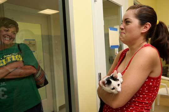 Before adopting a female kitten, Alyssa Bartholomew, 14, showed a male to her mother, Samantha, at the new Northeast Animal Shelter.