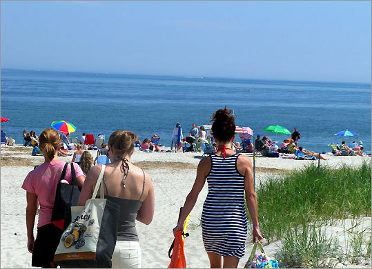 Beachgoers head for the strand at Crane Beach in Ipswich.