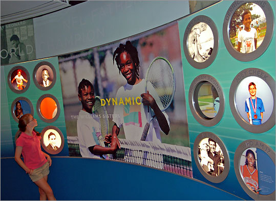 The Williams sisters smile in the 'Dreaming Big' exhibit.