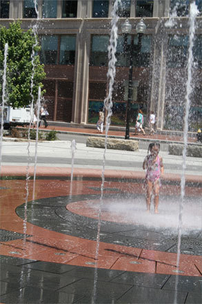 Although empty fountains can be fun, ones with water provide much better (and cooler) fun, especially when people are allowed to jump around inside them. One of Boston's newest modern fountains on the Rose Fitzgerald Kennedy Greenway sprays water at intervals and in different sequences and gives kids a place to cool down in the summer. At left, Anilesa, 6, of Nashua, N.H., was completely soaked by an unexpected jet of water that sprayed her in the face.