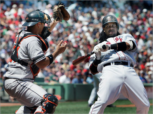 Manny Ramirez dodged a high pitch in the first inning.