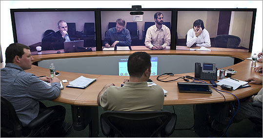 A teleconference gets under way at EMC Corp. in Hopkinton. On the other end are company managers in Santa Clara, California.