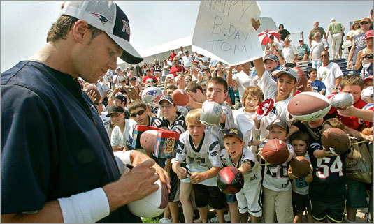 Tom Brady signs autographs during last year's training camp in Foxboro.