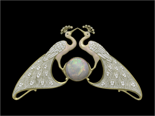 A gold, enamel, diamond, and opal double peacock necklace, from about 1900, on display at the MFA.