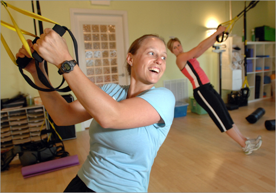 Instructor Meaghan Francis leads an exercise class at Select Fitness in Marblehead. The class is centered around a new lightweight exercise device that allows athletes to suspend themselves.