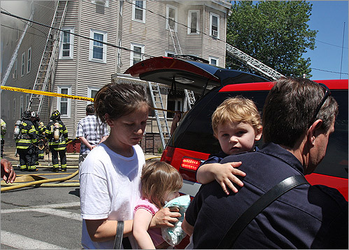 Jake Raley and his family evacuated as their home on Essex Street in Chelsea burned down. Chelsea firefighters battled temperatures nearing 90 degrees during the three-alarm fire.