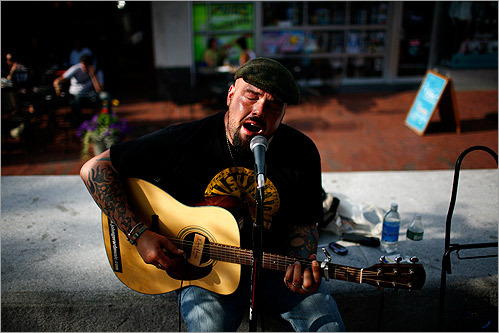 John Gerard played to a small crowd on Brattle Street in Cambridge. Gerard has been playing the guitar since he was 11 years old, but he's only been doing it on the street for the past year while he works on completing his second album.