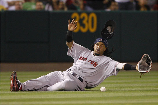 Manny Ramirez couldn't come up with this Maicer Izturis drive in the sixth inning of Friday's game against the Angels. The Sox stumbled to three losses in Anaheim.