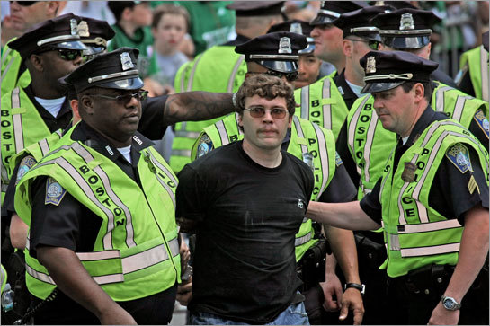 Boston police arrested this man after he allegedly trespassed on construction equipment and taunted police at the Celtics championship rally.