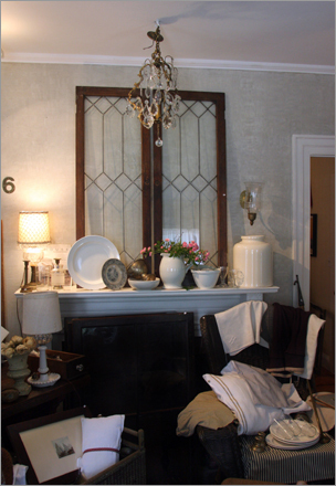 Leaded cabinet doors and a vintage French crystal chandelier lay amongst the antiques in one of the downstairs rooms.